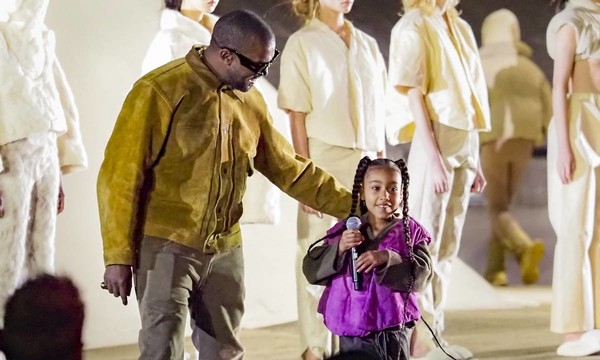 North West makes debut rap at Kanye's Paris fashion show